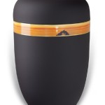 urn mat zwart ondergaande zon oranje